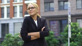 Lady in business suit standing outdoor, teacher of business school, slow-motion. Stock footage stock footage