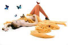Lady with butterfly. Beautiful lady with orange drapery with butterfly royalty free stock image