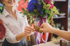Lady buying flowers in shop Royalty Free Stock Image