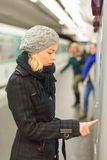 Lady buying ticket for public transport. Stock Images
