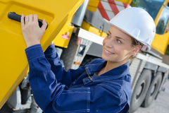 Lady at cab heavy plant vehicle Royalty Free Stock Images