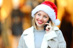 Lady calling on phone in christmas holidays stock photo