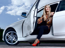 Lady and a car. Young pretty lady with a modern luxury car Stock Photos