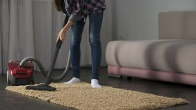 Lady carefully vacuuming bed mat, bringing house to order, allergy prevention. Stock footage stock video footage