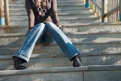 Lady in casual clothes sitting on stairs Royalty Free Stock Image