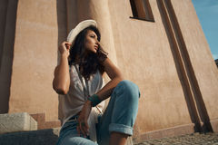Lady in casual summer outfit against ancient building. Royalty Free Stock Photography