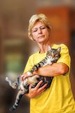 Lady With Cat. A lady holding her cat royalty free stock image