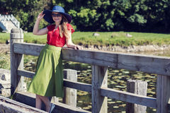 Lady catches the moment in the countryside Royalty Free Stock Images