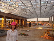 Lady CEO supplies roof for shopping mall Royalty Free Stock Photography