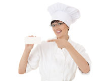 Lady chef pointing on empty card Stock Image