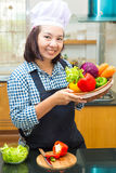 Lady chef preparing ingredient to make salad Royalty Free Stock Photography