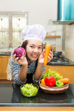 Lady chef preparing ingredient to make salad Royalty Free Stock Images