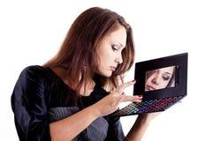 Lady choosing eyeshadow Royalty Free Stock Image