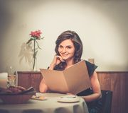 Lady choosing food in restaurant Stock Image