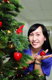Lady on a christmas tree Stock Image