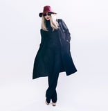 Lady in classic black coat and hat. fashion style Stock Photos