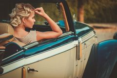 Lady in a classic car. Beautiful lady passenger in a  classic convertible Stock Photography