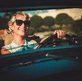 Lady in a  classic convertible Stock Photos