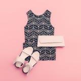 Lady clothing set. Dress and shoes. Trendy geometric prints Stock Image