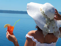 Lady and coctails. Beautiful woman drinking a cocktail by the sea,photography Royalty Free Stock Photos