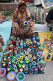 The lady with colourful clay pots. Woman painting clay pot in local art fair in bengal, India Royalty Free Stock Photography