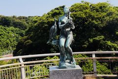 Lady combing hair statue at Jogashima island Royalty Free Stock Photos