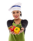 Lady cook offering peppers Stock Photos