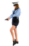 Lady cop posing with gun on white background Stock Image