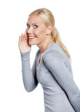 Lady covering mouth tells secrets Royalty Free Stock Images