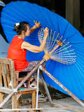 Lady crafting an Thailand Traditional Borsang Umbrella in Chiang Mai Royalty Free Stock Images