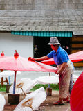 Lady crafting an Thailand Traditional Borsang Umbrella in Chiang Mai Stock Images