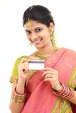 Lady with credit card in silk sari Royalty Free Stock Photos
