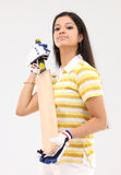 Lady with cricket bat Royalty Free Stock Photos