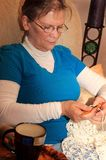 Lady Crocheting at Home Stock Images