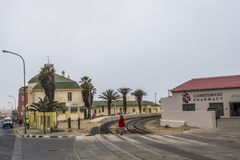 Lady crossing tracks at Luderitz royalty free stock image