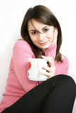Lady  with  cup in hand. Portrait of a  young lady  with  cup in hand Stock Images