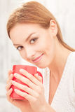 Lady with a cup of tea indoors Royalty Free Stock Photo