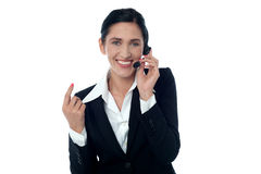 Lady customer support executive on call Royalty Free Stock Image