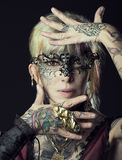 Lady in dark , with tattoo onface with mask Royalty Free Stock Photo
