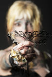 Lady in dark , with tattoo onface with mask Royalty Free Stock Image