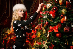 Lady decorates a tree stock photo