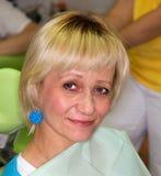 Lady before dental examination Stock Images