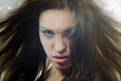 Lady Devil. Close-up portrait of the angry horrible female witch with blown hairs Stock Images