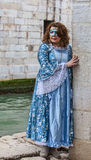 Lady Disguised in a Blue Costume Royalty Free Stock Photo