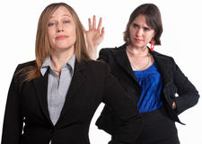 Lady Dismisses Her Boss. Mean female co-workers over white background royalty free stock images