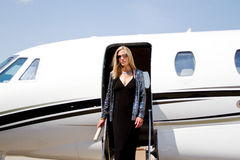 Lady Diva on steps of plane. Diva walking down steps of plane Stock Image