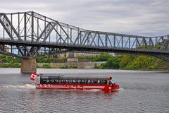 Lady Dive Tours amphibus, Ottawa, Canada. Lady Dive Tours amphibus on Ottawa River with Alexandra Bridge at the background, Ottawa, Ontario, Canada stock photos