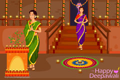 Lady with diya celebrating Diwali festival of India royalty free illustration