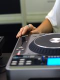 Lady DJ`s hand Stock Images