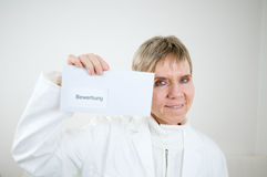 Lady doc show the application Stock Photography